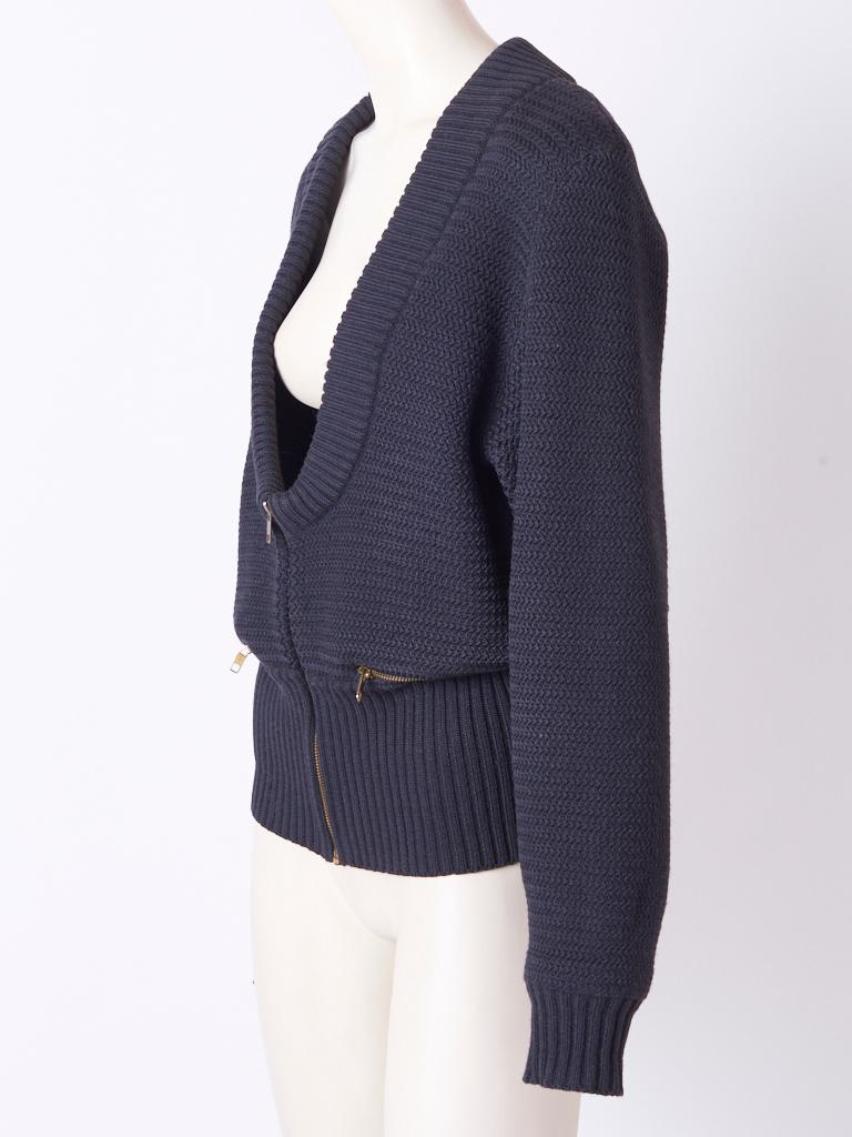 Azzedine Alaia, textured, wool knit, blouson/cardigan, in an off black tone, having a deep U neckline and an industrial, zipper closure with two horizontal zippers at the pockets.