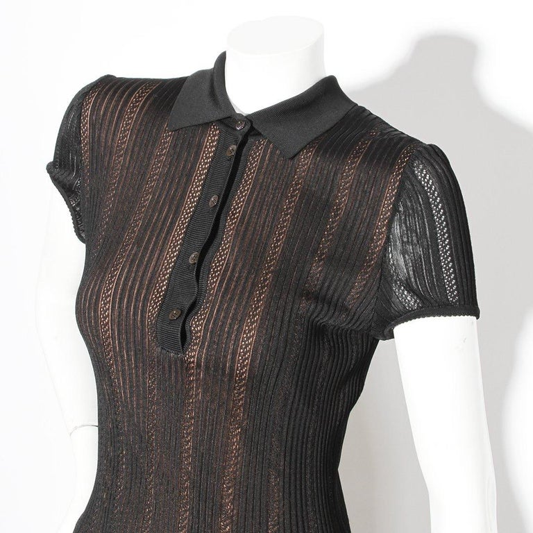 Product Details: Knit polo dress by Azzedine Alaia Circa 1996 Bodycon style  Polo collar  Button down front closure  Black knit with tan underlay  Ribbed ruffle bottom Made in Italy Condition: Excellent vintage condition, little to zero visible