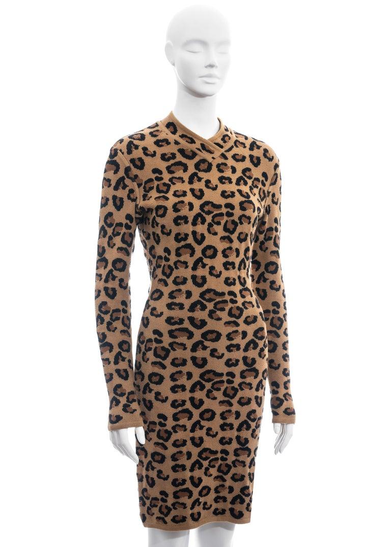 ▪ Azzedine Alaia leopard knit sweater dress ▪ 38% Wool, 36% Rayon, 23% Nylon ▪ V-neck  ▪ Figure hugging fit  ▪ Zip back fastening  ▪ Size Medium ▪ Fall-Winter 1991
