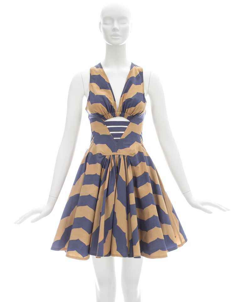 Azzedine Alaia; Cotton mini sundress in mauve and tan stripe print with caged cut-out, pleated skirt, and two hidden side pockets  Spring-Summer 1990