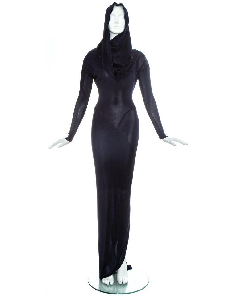 Azzedine Alaia navy acetate bias cut evening dress with signature draped hood, long zip fastening coiled around the body, bias cut panels with flat seams which contour the body and back vent with train.  One of Azzedine Alaia's most iconic and