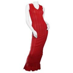 Azzedine Alaïa  red ribbed knit fishtail dress. Sculpted figure. Circa 1990