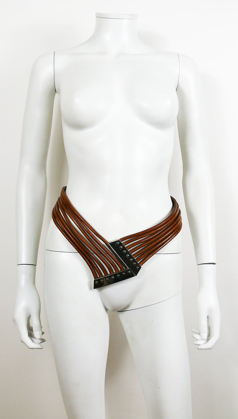 AZZEDINE ALAIA 1980s rare multri strings brown leather belt featuring a massive silver toned buckle.  Marked VACHER pour ALAIA. Made in France.  Indicated size : 75.  BELT CONDITION CHART - New or never worn : item is in pristine condition with no