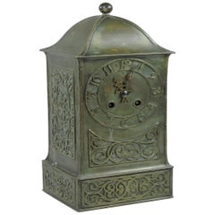 B G H, Attri an Arts & Crafts Brass Mantel Clock with Stylised Floral Chasing
