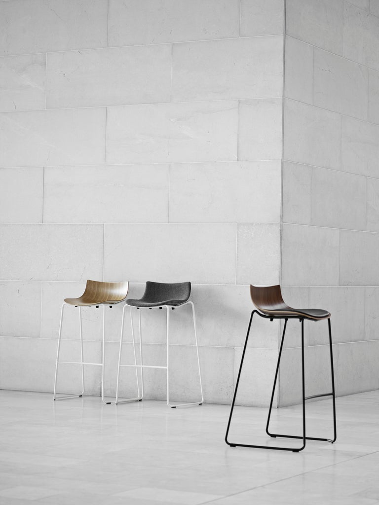 The BA004S Preludia Bar chair with upholstered seat by Brad Ascalon is perfect for social spaces. The chair's pared-down composition and unique form create an appealing atmosphere in any interior. The Preludia bar chair is part of the Preludia