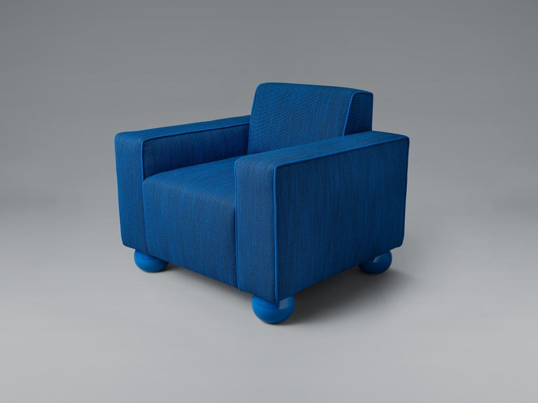 Inspired by the proportions of Art Deco club chairs, baby blue is an upholstered armchair by Los Angeles–based studio Another Human. The chair is upholstered in Kvadrat textiles with matching lacquer ball feet, however the piece can be fully