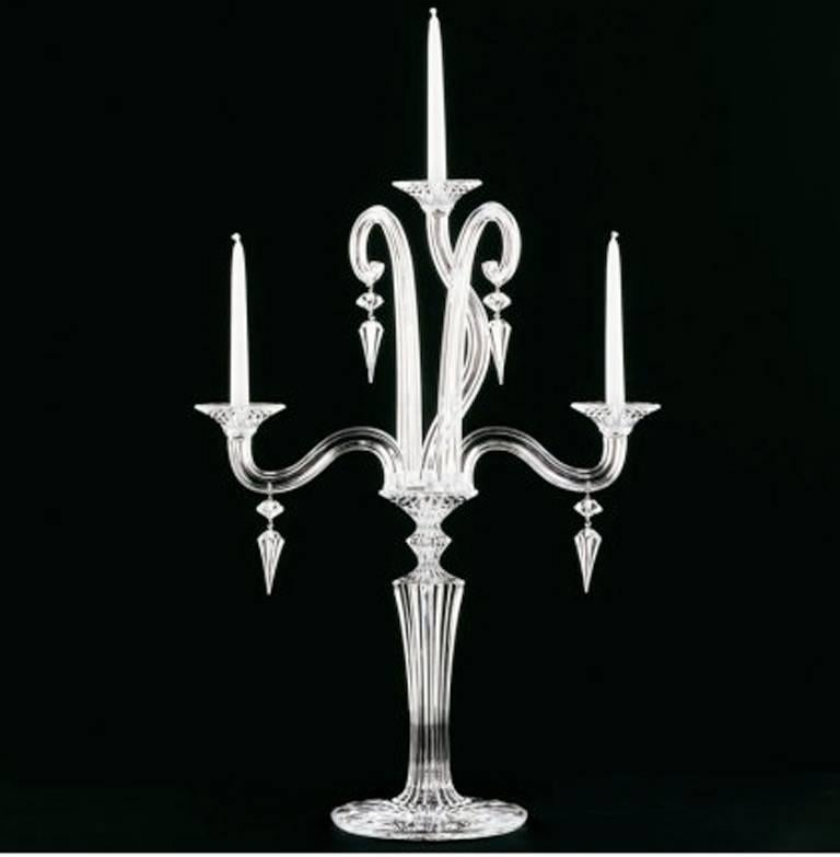 Elegant and sophisticated, the Mille Nuits collection offers fluid lines and intricated details. The three-light Baccarat candelabra is handcrafted in full-lead crystal that capture the light.