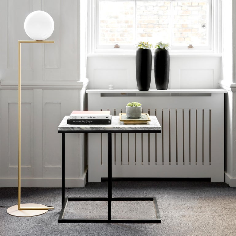 Brother to the Bacco coffee table, the Bacco side table possesses the strong lines and masculine glamour that the Bacco collection is known for, while also exuding a chic elegance due to its cantilevered design. Appearing as though it is floating in
