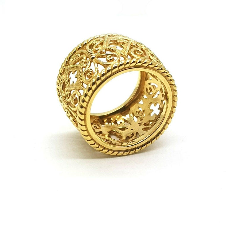 This is very beautiful stylish 18K yellow gold ring with ornament. The current ring size is 6.5-6.75US and it can not be resized due to its design.  Specifications:     main stone: NONE     additional: NONE       carat total weight: N/A     color: