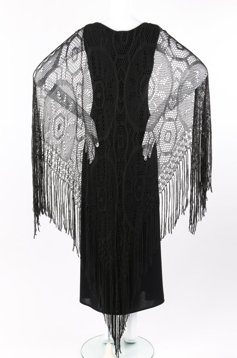 "BADGLEY MISCHKA c.1990's Black Crochet Knit Cape Shawl Sleeveless Midi Dress NWT Circa: 1990's Label(s): Badgley Mischka Designer: Mark Badgley, James Mischka Style: Sleeveless midi dress Color(s): Black Lined: Partial Marked Fabric Content: ""70%"