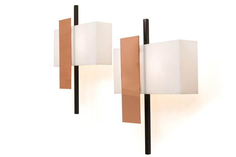Post-constructivist sconces by the Swiss design and manufacturing company BAG Turgi, 1960s. The geometric design is composed of Perspex and copper and steel.