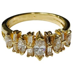 Baguette and Round Brilliant Diamond Ring in 14 Karat Yellow Gold