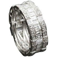 Baguette and Round Diamond Eternity Ring in 18 Karat Gold