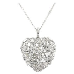 Baguette cut diamond heart set in 14k white gold total weight 2.81cts.