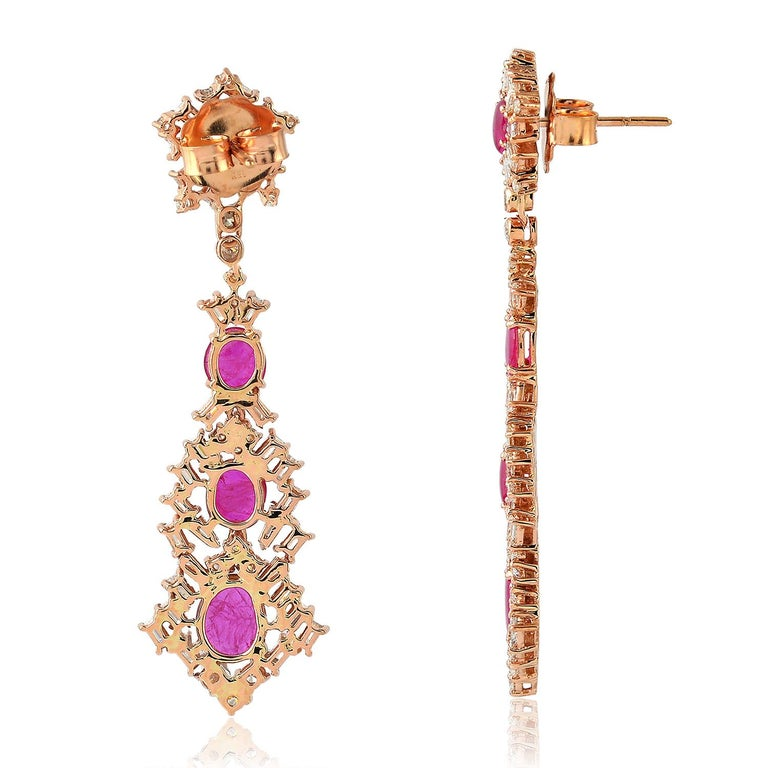 Cast from 18-karat gold, these stunning baguette diamond drop earrings are hand set with 4.1 carats ruby and 3.4 carats of glittering diamonds.  FOLLOW  MEGHNA JEWELS storefront to view the latest collection & exclusive pieces.  Meghna Jewels is