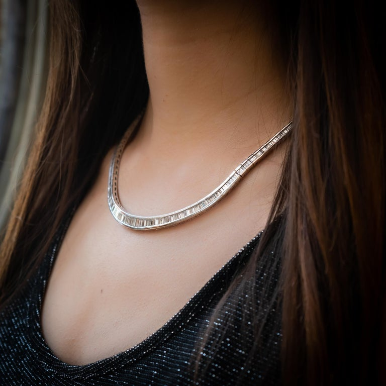 A diamond necklace set with channel set baguette-cut diamonds in platinum settings, with approximately 20.00ct of diamonds, graduated, tapering towards the back.