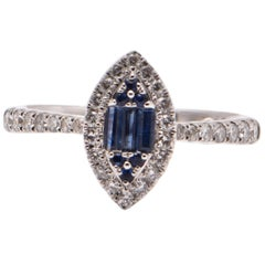 Baguette Sapphire and Diamond Halo Ring in 18 Carat White Gold