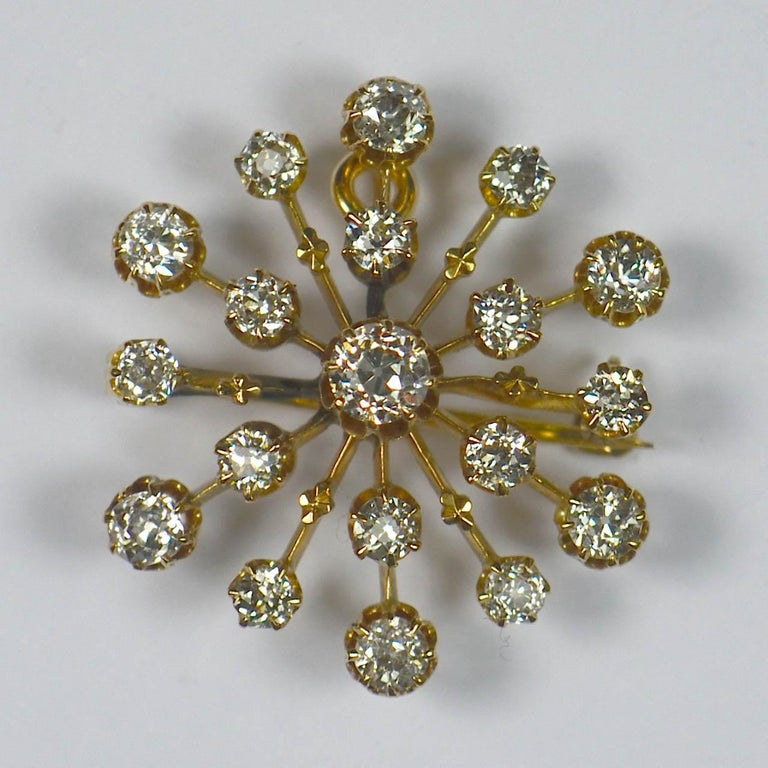 A simple but stylish 18 karat gold pendant lavishly sprinkled with diamonds in a snowflake design by the American firm Bailey, Banks & Biddle, circa 1890.  May also be worn as a brooch.  Set with 19 old cut diamonds with a total estimated weight of