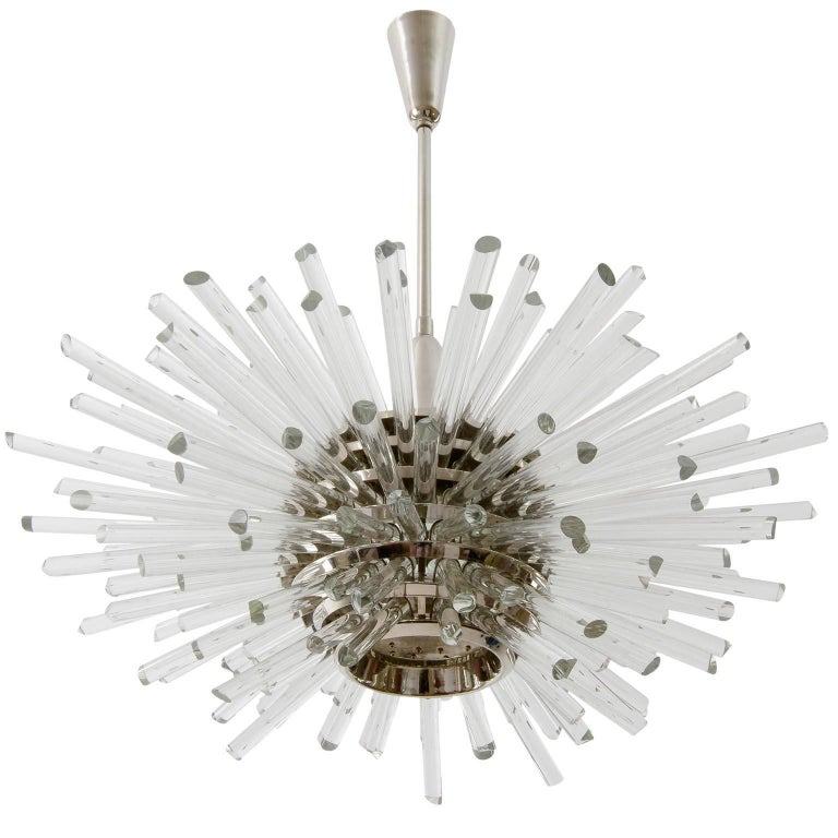 A fantastic Sputnik chandelier by Bakalowits & Söhne, Vienna, Austria, manufactured in midcentury, circa 1970 (late 1960s or early 1970s).  The fixture consists of a layered multi-tier structure made of nickel-plated brass rings and glass rods with