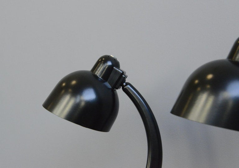 Bakelite table lamps, circa 1940s  - Price is per lamp - Bakelite construction - Adjustable shade and arm - Takes E27 fitting bulbs - On/Off switch on the base - German, 1940s - Measures: 43cm tall x 17cm wide x 25cm deep  Condition