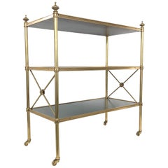 Baker Directoire Brass and Leather Rolling Shelves