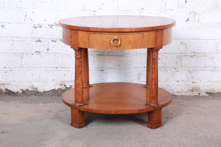 A gorgeous French Empire style cherrywood occasional side table or nightstand