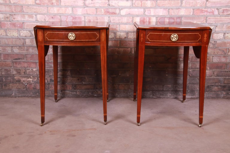 A gorgeous pair of Sheraton style Pembroke nightstands or tea tables  By Baker Furniture