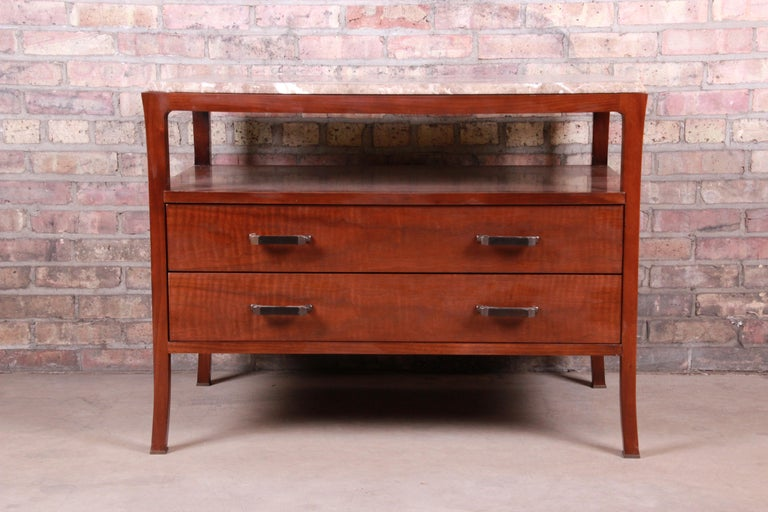 A gorgeous modern marble-top buffet server or entry table  By Bill Sofield for Baker Furniture  USA, early 21st century  Mahogany, with beveled marble top.  Measures: 38