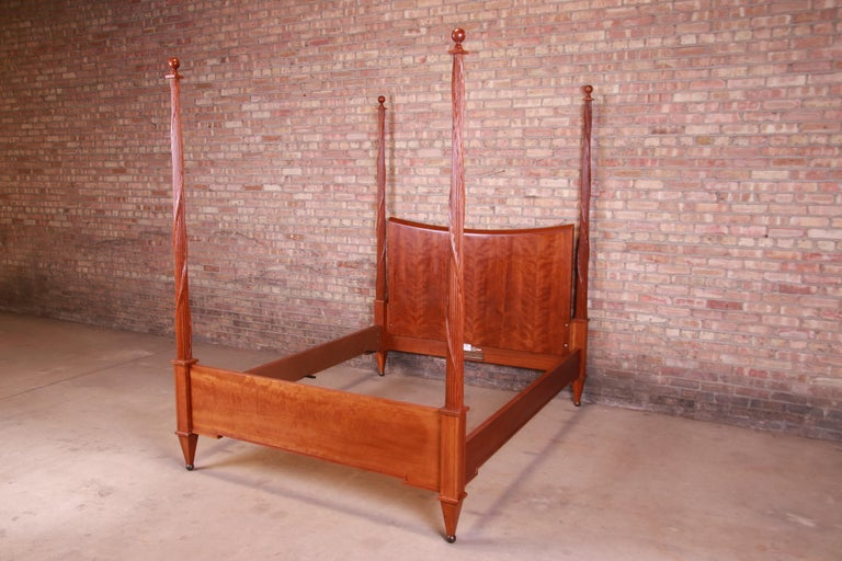 A gorgeous neoclassical style carved cherrywood four poster queen size bed  By Baker Furniture  USA, late 20th century  Measures: 66.75