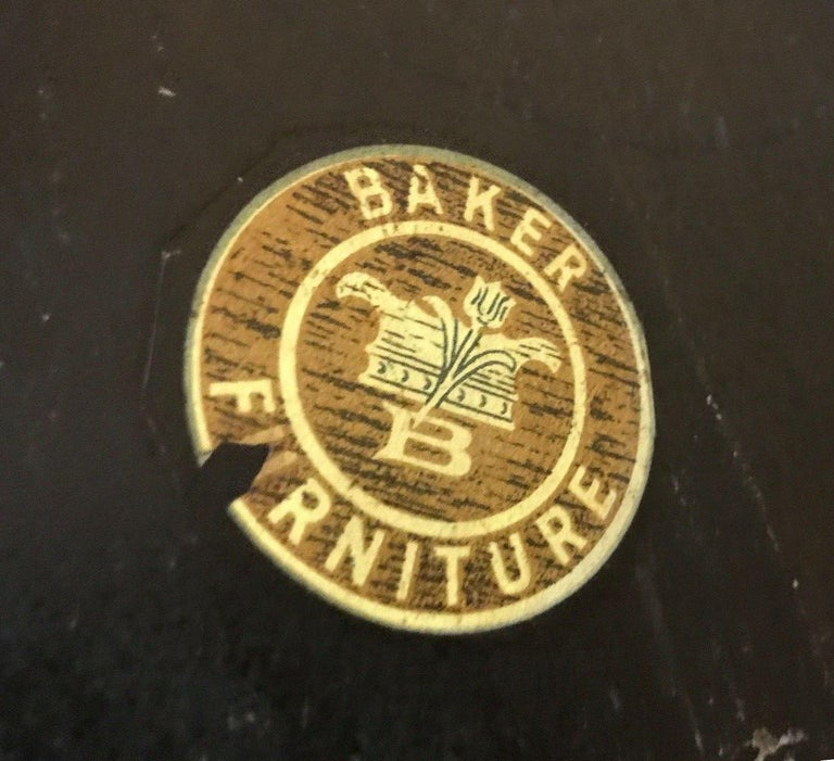 Baker Furniture Verre églomisé gilt ebonized antique coffee table, labelled. Baker marking dates to 1940 according to my research. Extremely rare piece.