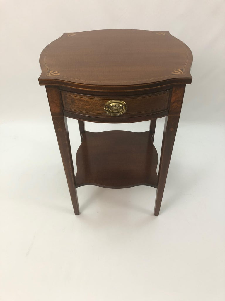 Classic mahogany and satinwood inlay side table with pretty pointed corners and fan design, tapered legs with bellflower decoration, and single drawer.