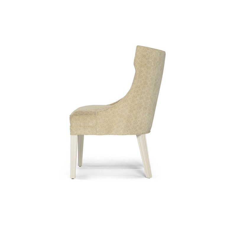 Make a bold statement with this unique Balboa dining chair. Designed with ample space, this chair consists of sloped arms and a rounded back that is elegantly angled to embrace your guest with utmost comfort. Designed to compliment the Balboa dining