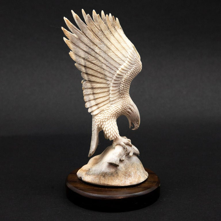 Bald Eagle with Fish Moose Antler Carving.  Detailed moose antler carving of a bald eagle holding a fish, from Indonesia. This is a one of a kind object. The moose antler was sourced in North America and then sent to Asia for carving. Quality of