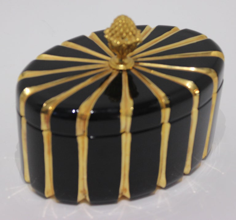 Vintage 1970s oval jet black glass box with 24-karat gold and bronze doré lid handle by Baldi Firenze, Italy. This is a rare example of Baldi Firenze's exclusive workshop before their current House Jewels line was marketed.