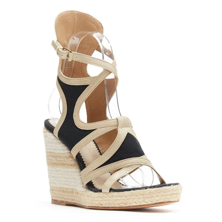 BALENCIAGA beige leather black canvas strappy gladiator espadrille platform EU38 Brand: Balenciaga Designer: Nicolas Ghesquiere Model Name / Style: Platform Material: Leather Color: Grey Pattern: Striped Closure: Ankle strap Extra Detail: Ultra High