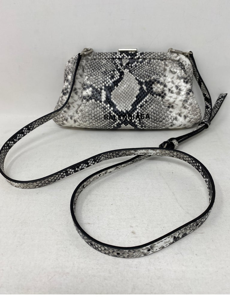 Balenciaga Black and White Crossbody Bag. Silver top handle. Can be worn as a clutch or as a crossbody bag. Mint like new condition. Guaranteed authentic.