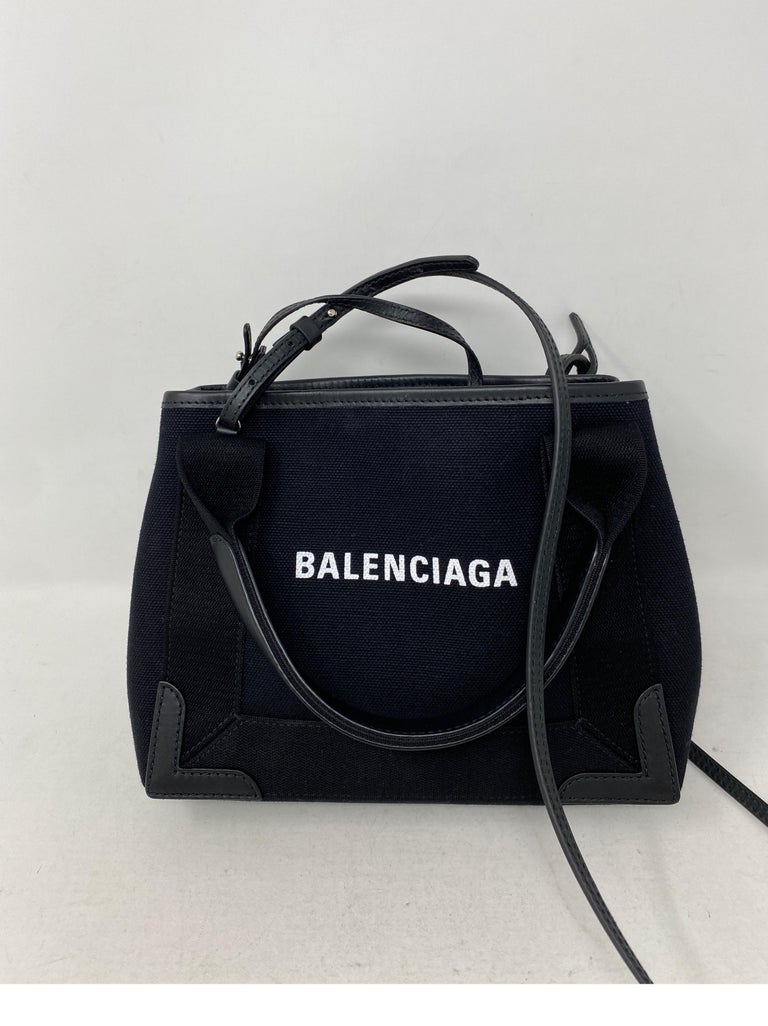 Balenciaga Black Canvas Cotton Bag. Can be worn as a crossbody too. Cute small size bag. Mint like brand new condition. Includes pouch inside. Guaranteed authentic.