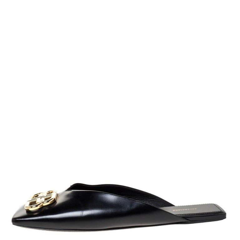 Supremely comfortable and stylish, these mules from the house of Balenciaga features a black leather body. They come with gold-tone BB detailing on the uppers and lined insoles. Style the mules with culottes or cropped trousers to show them