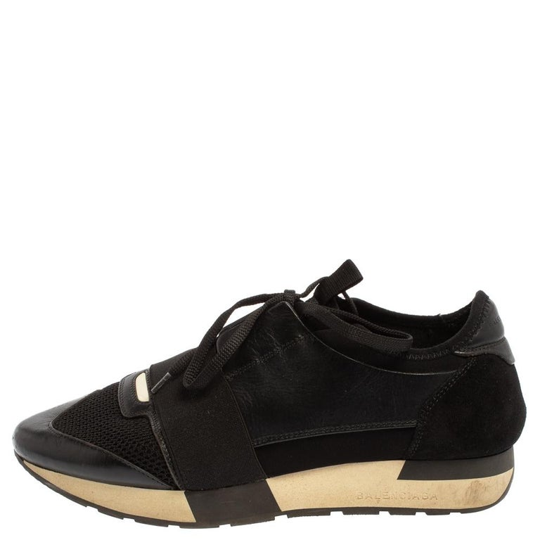 Let your latest shoe addition be this pair of Race Runners sneakers from Balenciaga. These black sneakers have been crafted from suede, leather, and mesh and feature a chic silhouette. They flaunt covered toes, strap detailing on the vamps, and