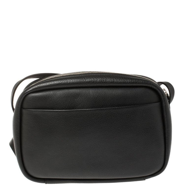 Designed to last, this beautiful bag from Balenciaga will make a prized buy. Comfortable and easy to carry, this leather creation comes in black with a puppy and kitten detailed on the front. It has a shoulder strap and an interior lined with