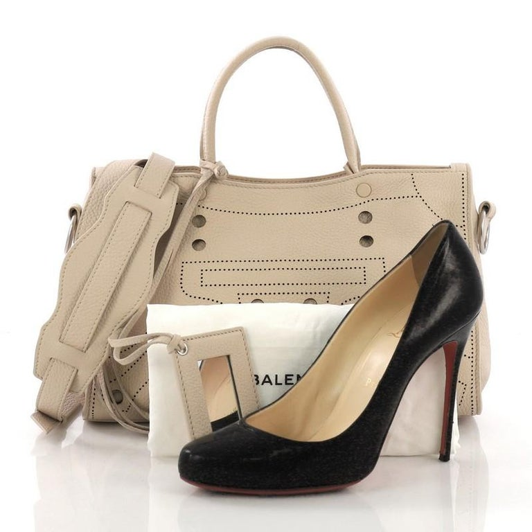 2d9c2e3d11a This Balenciaga Blackout City AJ Handbag Leather Small, crafted in beige  leather, features dual