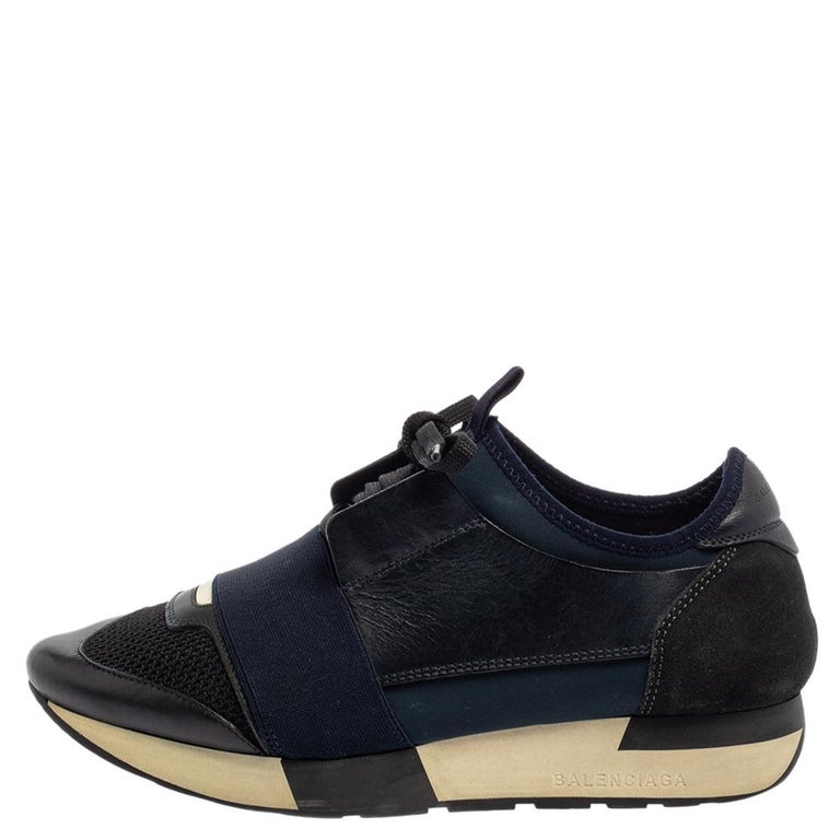 Let your latest shoe addition be this pair of Race Runner sneakers from Balenciaga. These blue and black sneakers have been crafted from suede, leather, fabric, and mesh and feature a chic silhouette. They flaunt covered toes, strap detailing on the