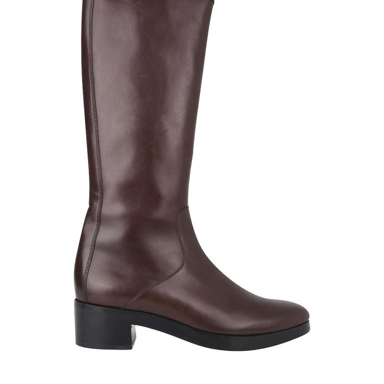 Guaranteed authentic Balanciaga clean lined knee high boots.  Small platform and perfect toe for a timeless classic boot. Side zipper for easy access.   Rear has a stitch detail. NEW or NEVER WORN. Light natural marking in certain light. final