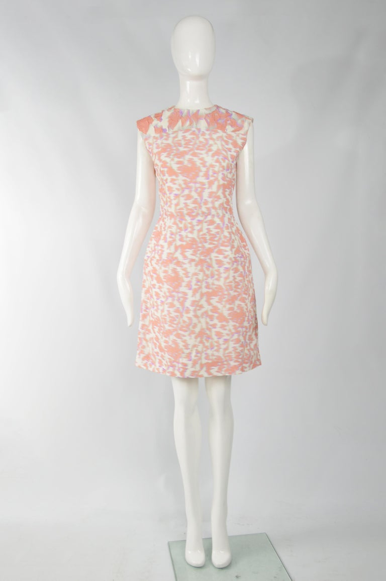 A stunning Balenciaga dress from the Spring Summer 2014 collection, designed by Alexander Wang. In a white, peach and purple acetate-silk blend with a textured, cloqué top and structured hips. Perfect for the day or at a party in the evening.  Size: