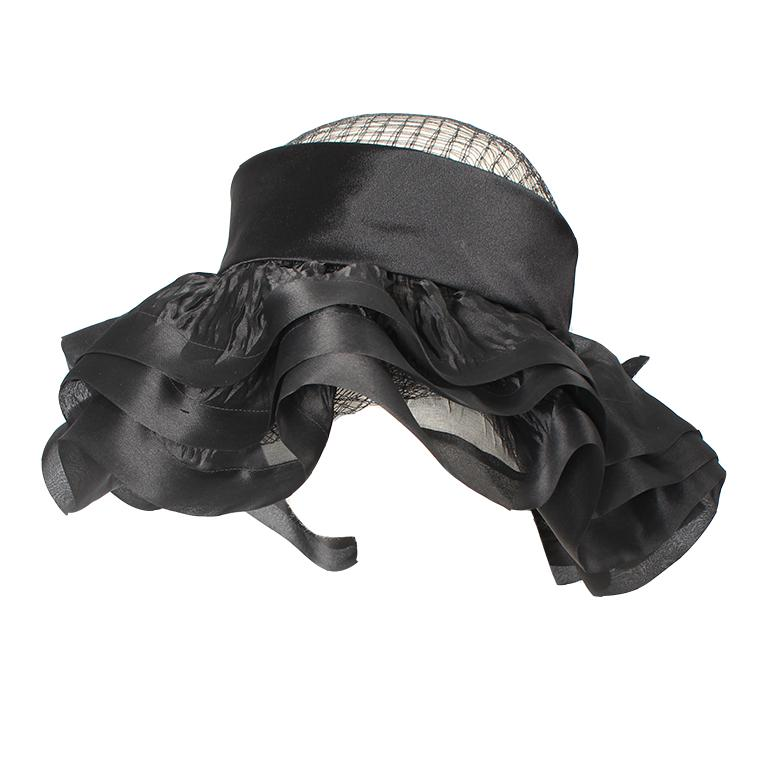 - Balenciaga silk and mesh hat designed by Cristóbal Balenciaga - Sheer net top surrounded by layers of black silk  - Gathered by black silk floral embellishment at the back