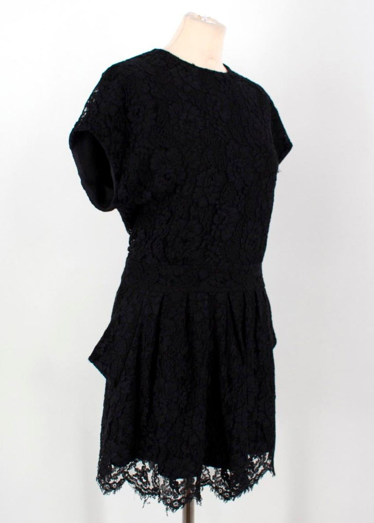 Balenciaga Lace Little Black Dress  - Black lace dress - Round neckline - Short sleeves - Rear button fastening with lace covered buttons - Exposed side slip pockets - Scalloped hem with raw finish - Fixed waistband - Short length - Silk lining -