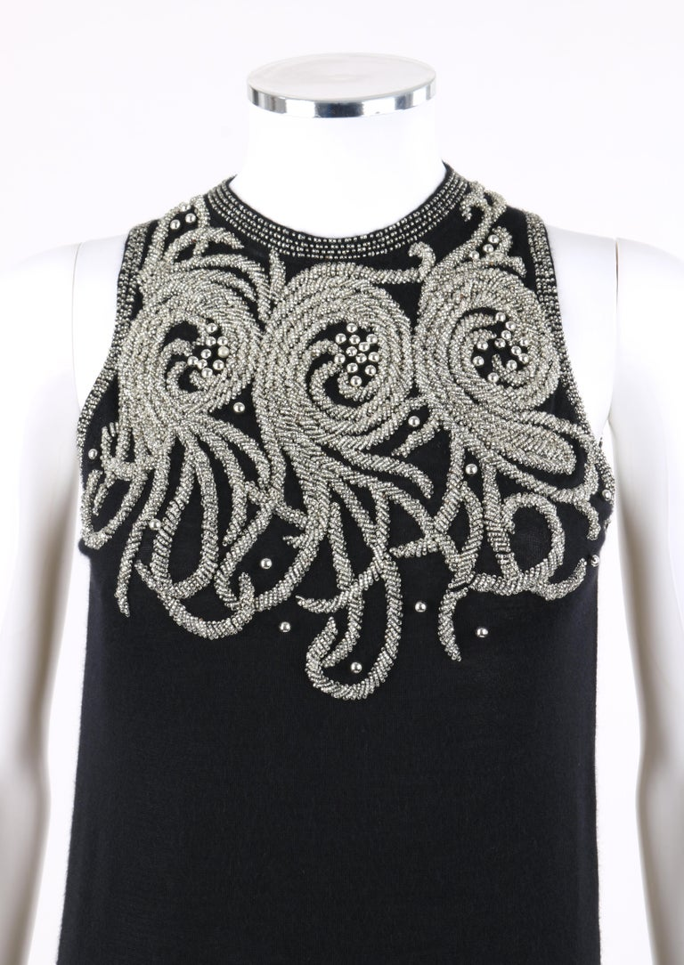 BALENCIAGA S/S 2006 Black Silver Embellished Cashmere Sleeveless Sweater Top   Brand / Manufacturer: Balenciaga Collection: S/S 2006 Designer: Nicolas Ghesquiere Style: Sleeveless sweater top Color(s): Shades of black and silver Lined: No Marked