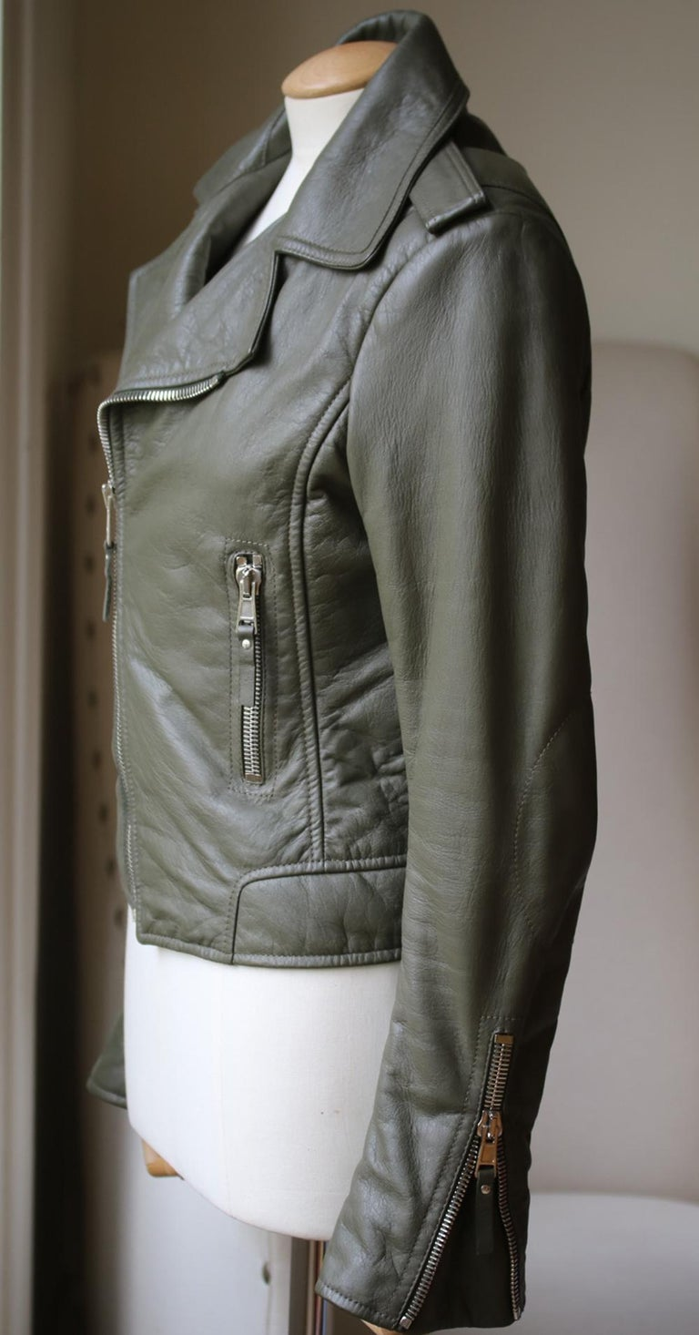 Cut for a close fit, this piece is crafted from supple textured-leather and has an asymmetric zip fastening and silver hardware. Green textured-leather. Asymmetric zip fastening through front. 100% leather (Lamb); lining: 100% rayon.   Size: FR 40