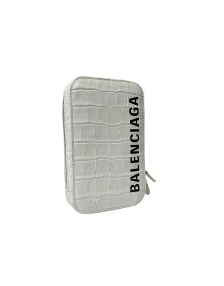 Mini shoulder bag by Balenciaga, made of white crocodile patterned leather with black print and silver hardware. Zip closure, equipped with internal and external compartments. Equipped with adjustable and removable shoulder strap. The bag is in