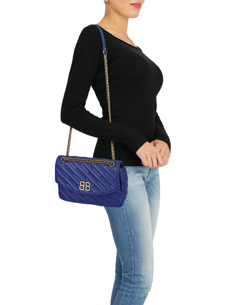 Bag, leather, other patterns, monogram logo, button fastening, gold-tone hardware, internal zipped pocket, internal pocket, day bag  Includes: - Dust bag  Product Condition: Very Good Lining: slightly visible stains, visible scratches. Corners and